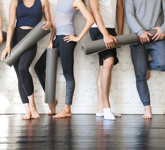 Group holding yoga mats to promote Much Ado About Insurance Brokers - Leisure Insurance