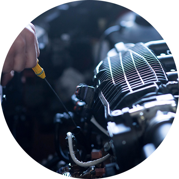 Mechanic fixing car to promote Much Ado About Insurance Brokers - Motor Trade Insurance