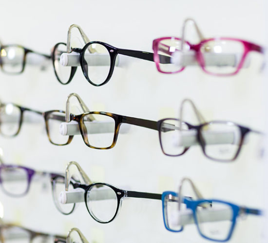 Glasses lined up in opticians to promote Much Ado About Insurance Brokers - Shops, Offices & Salons Insurance