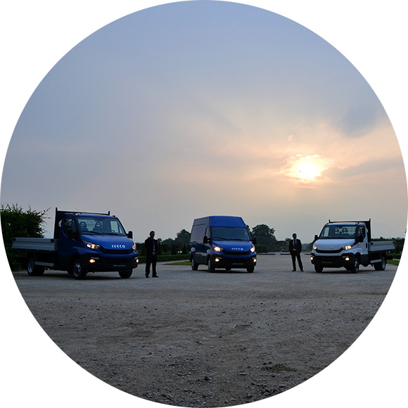 Vans parked in fields at sunset to promote Much Ado About Insurance Brokers - Vans, trucks and fleet Insurance