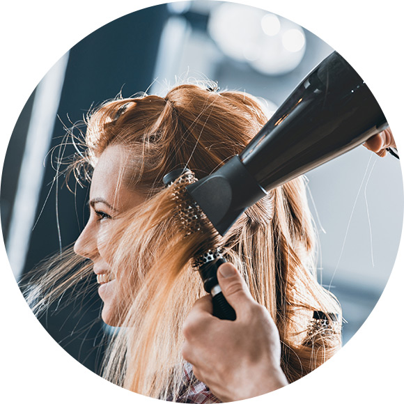 Woman having a blow-dry at a hairdressers to promote Much Ado About Insurance Brokers - Liabilities and Identities Insurance