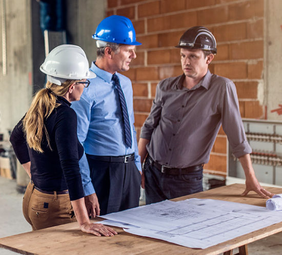 Three construction workers in conversation to promote Much Ado About Insurance Brokers - Manufacturing and Construction Insurance