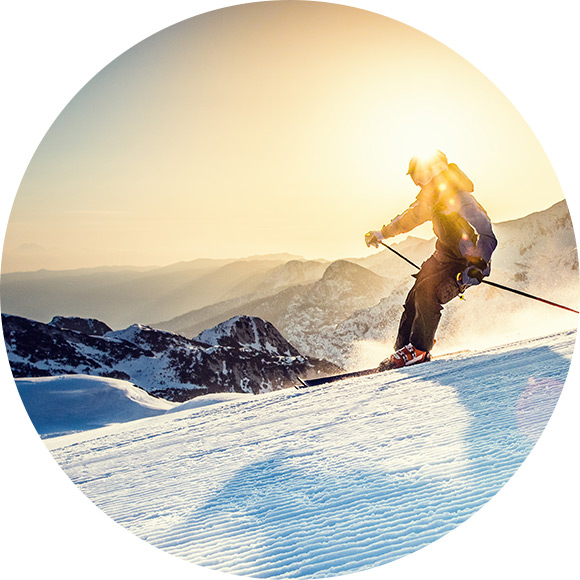 Man skiing down a slope abroad to promote Much Ado About Insurance Brokers - Personal Travel Insurance